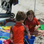 Amanda (10) & Jack (7) enjoying our Deluxe Beach Package and a Bag o' Beach Toys.